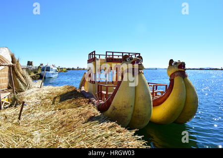 Typical peruvian boat (aka Totora boat) in the island of Uros, Titicaca lake, Peru. The tours to this island departure - Stock Photo