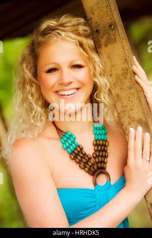 Junge, attracktive Frau mit blonden Locken im Portrait - blond woman with curls - Stock Photo