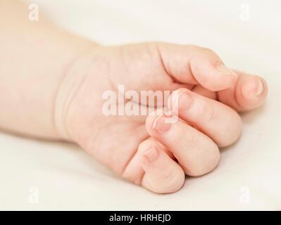 Kinderhand - childrens hand - Stock Photo
