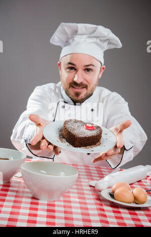 Kuchenbaecker - cake baker - Stock Photo