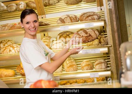 Angestellte in der Baeckerei - clerk in a bakery - Stock Photo