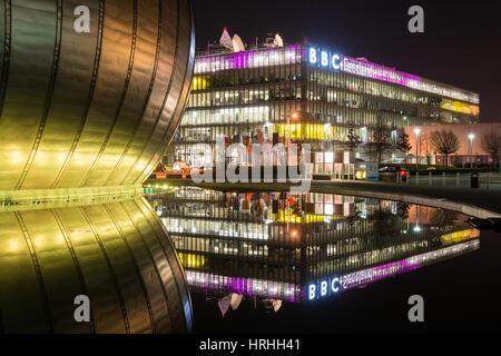 BBC Scotland headquarters, reflected in the water surrounding Glasgow IMAX, Pacific Quay, Glasgow, Scotland - Stock Photo