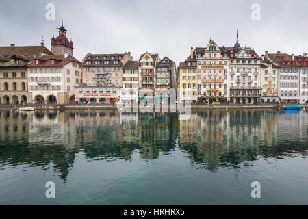 The typical buildings of the old medieval town are reflected in River Reuss, Lucerne, Switzerland - Stock Photo