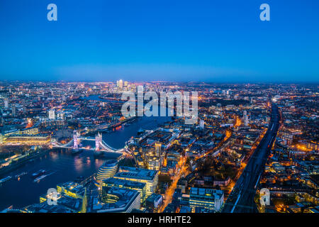 High view of London skyline at dusk along the River Thames from Tower Bridge to Canary Wharf, London, England, United - Stock Photo