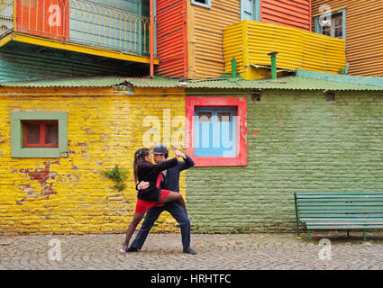 Couple dancing tango on Caminito Street, La Boca, Buenos Aires, Buenos Aires Province, Argentina - Stock Photo