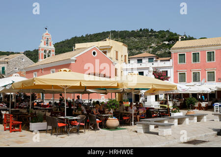 Cafes and restaurants in main square of Gaios town, Paxos, Ionian Islands, Greek Islands, Greece - Stock Photo