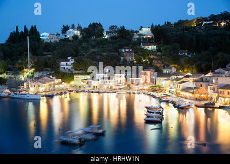View over harbour at night, Loggos, Paxos, Ionian Islands, Greek Islands, Greece - Stock Photo