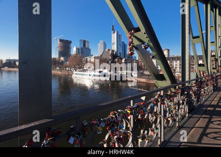 Eiserner Steg, iron footbridge with view to financial district, Frankfurt, Hesse, Germany - Stock Photo