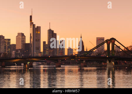 View over Main River to Floesserbruecke bridge and financial district, Frankfurt, Hesse, Germany - Stock Photo
