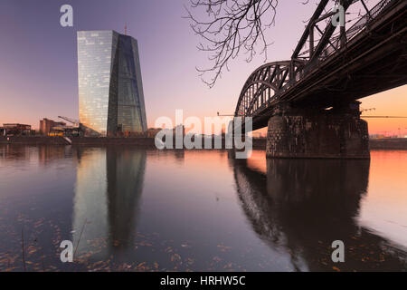 View over Main River to European Central Bank, Frankfurt, Hesse, Germany - Stock Photo