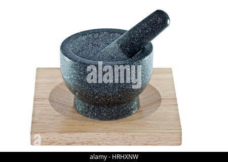Mortar and pestle on a wooden chopping board isolated on a white background - Stock Photo