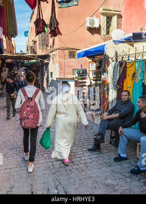 Marrakesh, Morocco - December 8, 2016: People and shops in the famous souks of Marrakesh, Morocco, Africa. - Stock Photo