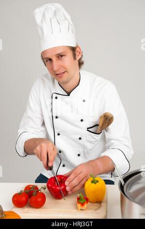 Cook prepares vegetables, Koch bereitet Gemuese zu - Stock Photo