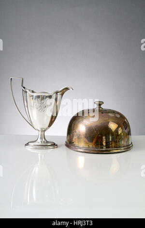 Polished Cup and Tarnished Cake Dome - Stock Photo