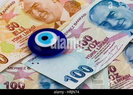 Turkish lira and evil eye (eye of the Prophet) - Stock Photo