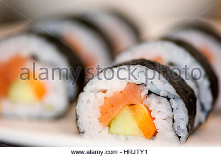 A dish of sushi, seaweed rolls and fish. - Stock Photo