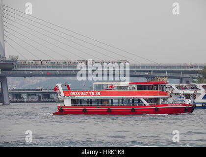FERRY CROSSING GOLDEN HORN WITH GOLDEN HORN METRO BRIDGE IN THE BACKGROUND ISTANBUL TURKEY - Stock Photo