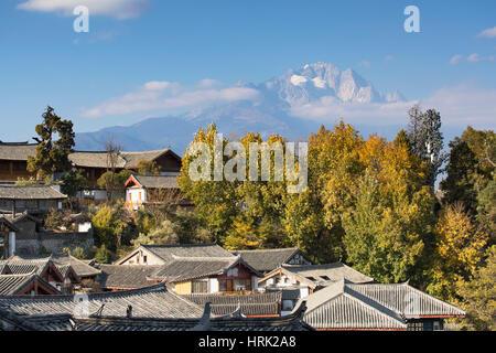View of Jade Dragon Snow Mountain and Lijiang (UNESCO World Heritage Site), Yunnan, China - Stock Photo