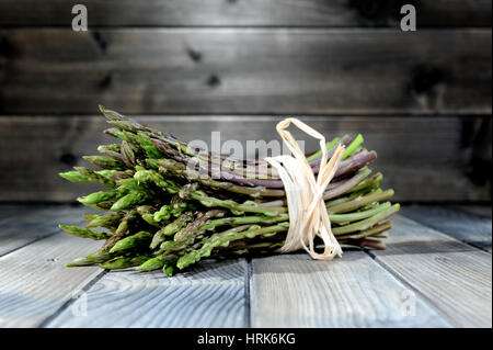 Close-up of tasty natural and vitamin-rich fresh asparagus freshly picked in the countryside, photographed on an - Stock Photo