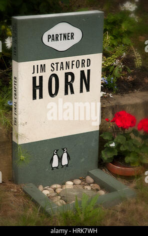 Grave stone of Jim Stanford Horn in shape of paperback book at Highgate Cemetery - Stock Photo