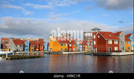 Colourful Scandinavian style wooden houses at Reitdiephaven. Modern housing development in the city of Groningen, - Stock Photo