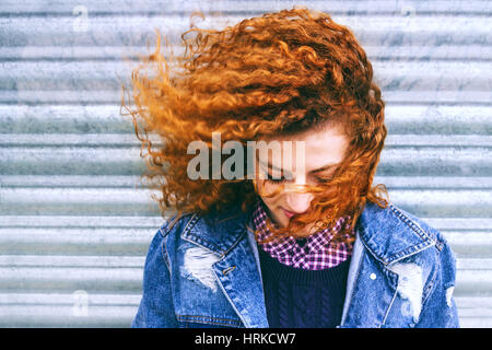 Portrait of a beautiful redhead teenager - Stock Photo