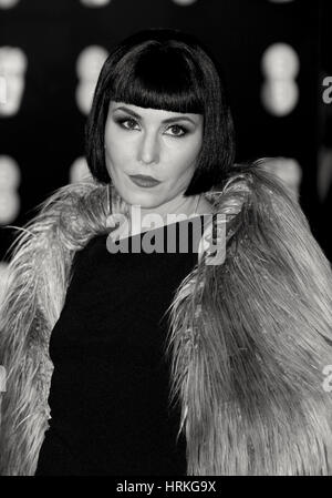 Noomi Rapace ( Image digitally altered to monochrome ) attends The EE British Academy Film Awards (BAFTA) at the - Stock Photo