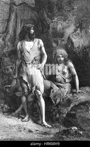 Prehistoric man & woman stone age reenactors trying to ...  Prehistoric man...