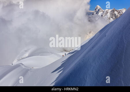 Climbers on the Mont Blanc massif. View from Aiguille du Midi Mount 3,842 m, France - Stock Photo