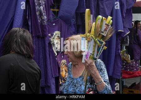 Caracas, Dtto Capital / Venezuela - 04/04/2012. Old woman with Palms blessed in downtown Caracas during Easter. - Stock Photo