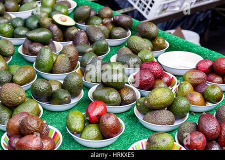 Avocado on display at Borough Market in London - Stock Photo