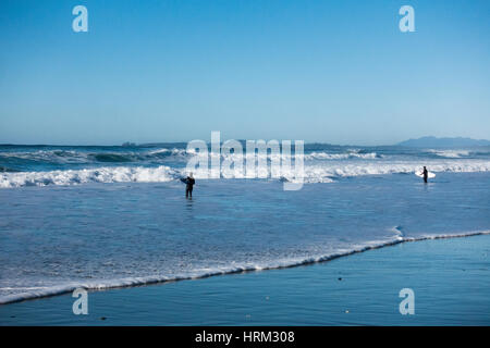 Surfer at Long Beach, Tofino, British Columbia - Stock Photo