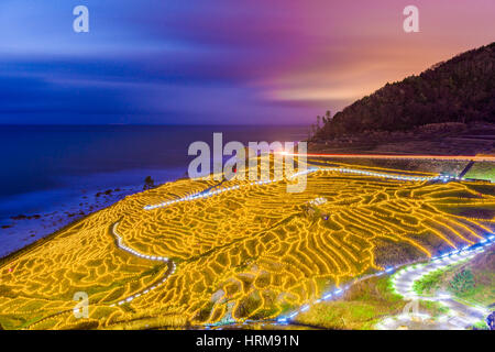 Wajima, Japan at Shiroyone Senmaida rice terraces at night. - Stock Photo