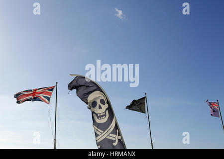 Jolly Roger Skull and Crossbone and Union Flag - Stock Photo