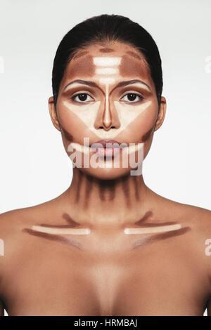Close up portrait of contour and highlight makeup on female model. Professional contouring face makeup technique.