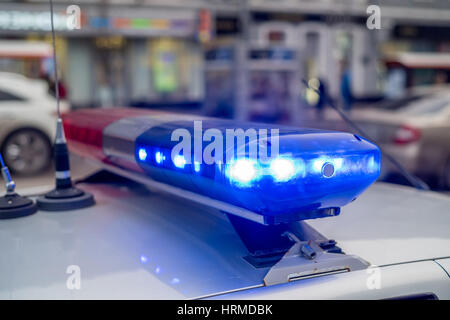The roof-mounted activated lightbar of police vehicle - Stock Photo