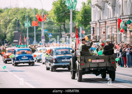Gomel Homiel Belarus, Celebration Victory Day 9 May. Back View Of Decorated Auto Cortege With Veterans Of WW2 On - Stock Photo