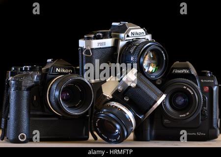 Pile of old retro film cameras - Nikon, Olympus