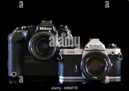 Vintage Nikon FM2 and FE film cameras - Stock Photo