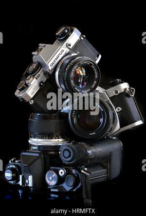 Pile of old retro film cameras - Nikon, Olympus Stock Photo