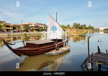 Traditional sail boat on the Thu Bon River. Hoi An, Quang Nam Province, Vietnam. - Stock Photo