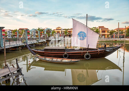 Traditional Vietnamese sail boat moored on Thu Bon River. Hoi An Ancient Town, Quang Nam Province, Vietnam. - Stock Photo