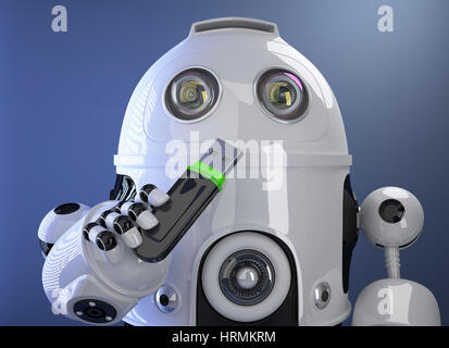 Robot holding USB memory stick. Contains clipping path - Stock Photo