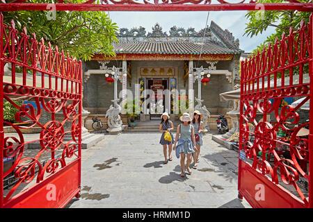 Tourists visiting Cantonese (Quang Trieu) Assembly Hall. Hoi An Ancient Town, Quang Nam Province, Vietnam. - Stock Photo