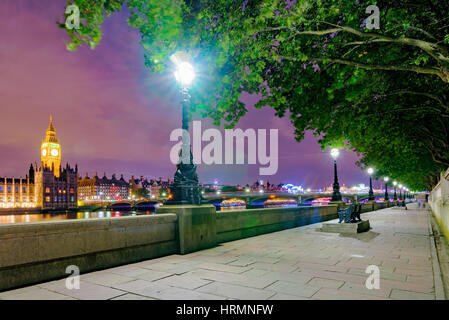 Riverside path at night with view of London - Stock Photo