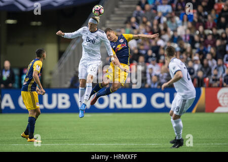 Vancouver, Canada. 2 March, 2017. Break Shea (20) of Vancouver Whitecaps, beats  Aaron Long (33) of New York Red - Stock Photo