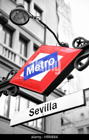 Metro sign in Madrid, Sevilla station. Partly black and white image - Stock Photo