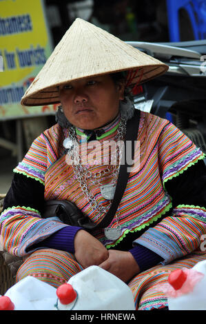 SAPA, VIETNAM - FEBRUARY 22, 2013: Hmong women at Bac Ha market in Northern Vietnam. Bac Ha is hilltribe market - Stock Photo