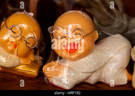 Sleeping chinese, sleeping man with bald and glasses, clay figure, souvenir, singapore, asia, singapore - Stock Photo