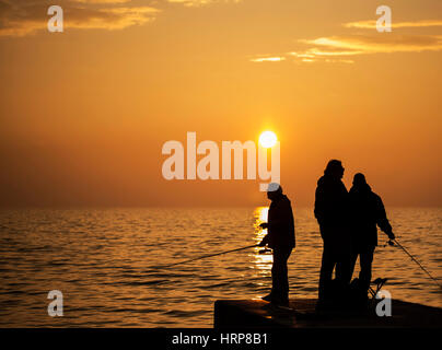 Piran, Slovenia, EU - Februar 18, 2017: A group of fishermans are catching fish for a hobby and relaxing themselves - Stock Photo